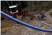 Trenchless installation using a plough, click to zoom